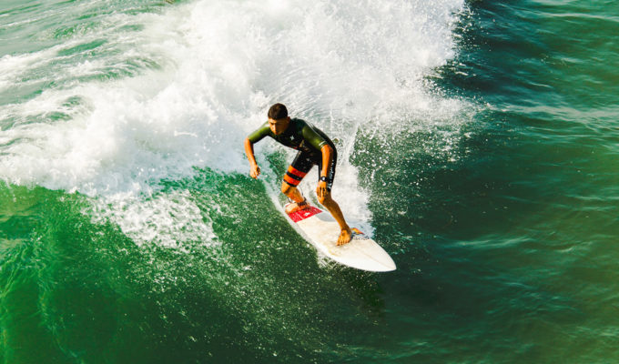 Surfboards are thinner and more maneuverable than SUPs when comparing surfboards with paddle boards