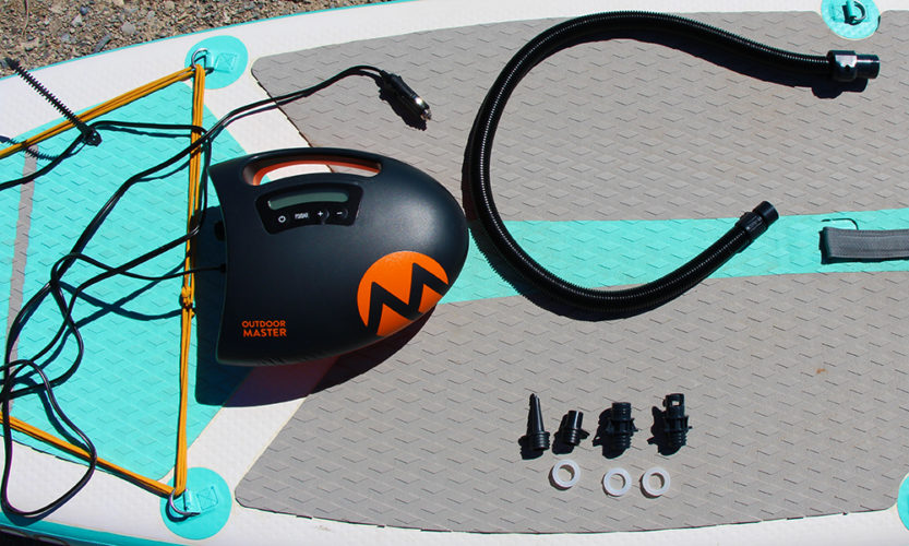The Outdoor Master Shark Electric SUP Pump with everything included in the box, minus the paddle board.